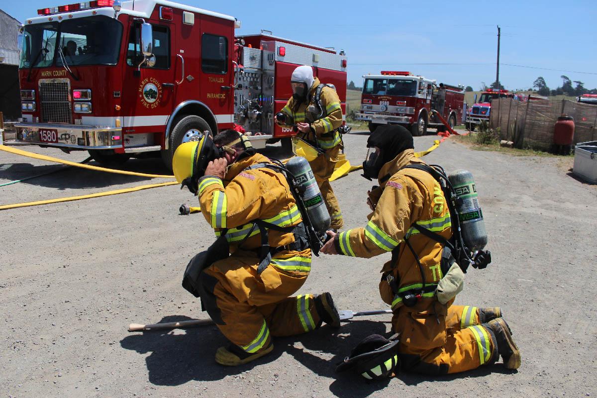 Lou, Kenji, Justin donning breathing apparatus