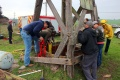 Capt. Stoerzinger and others look into the well